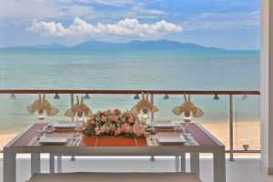outdoor dining table with sea view